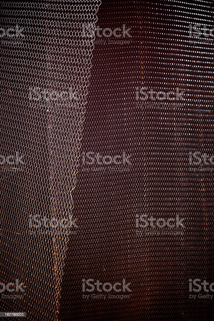 metal mesh red lit background stock photo