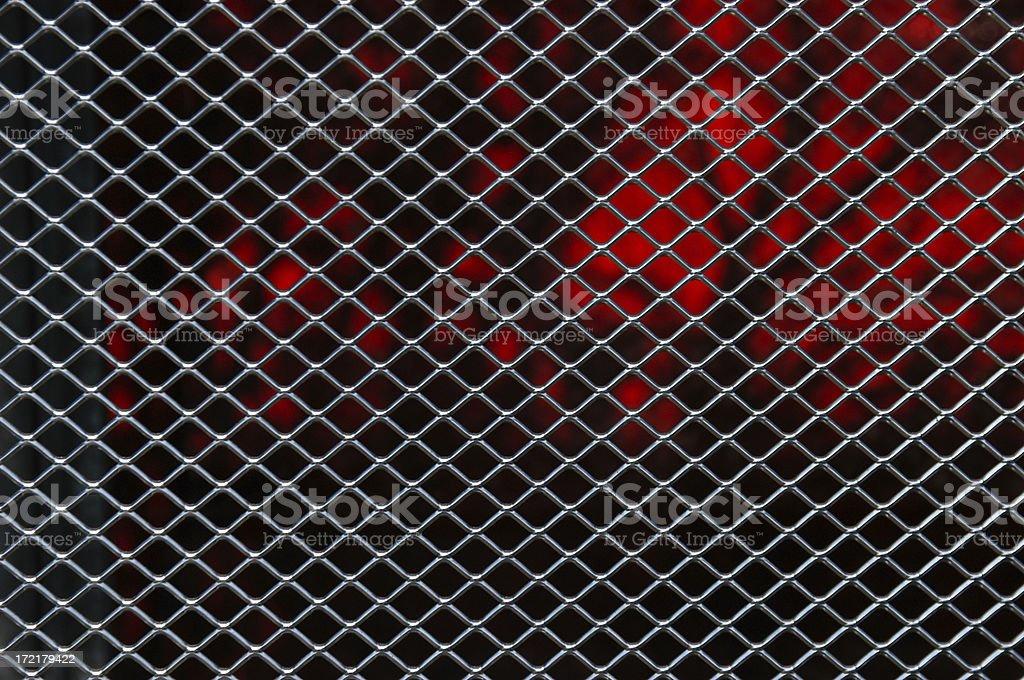 Metal Mesh / Red Wall royalty-free stock photo