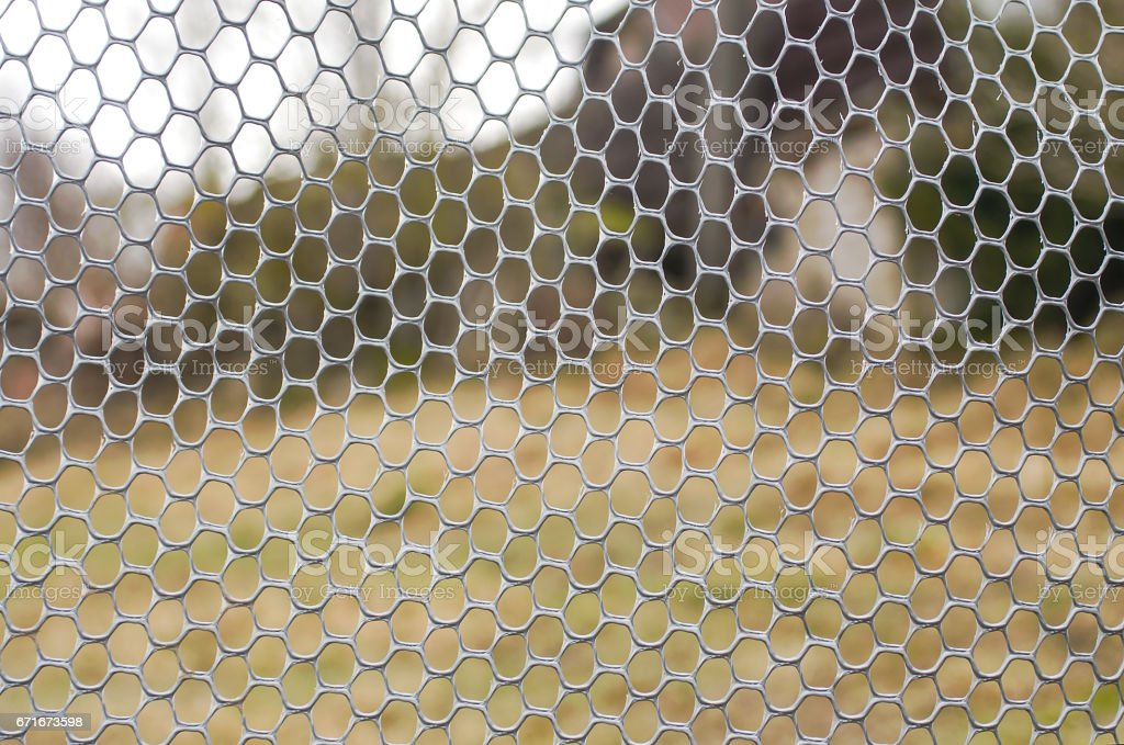 Metal mesh with blur background stock photo