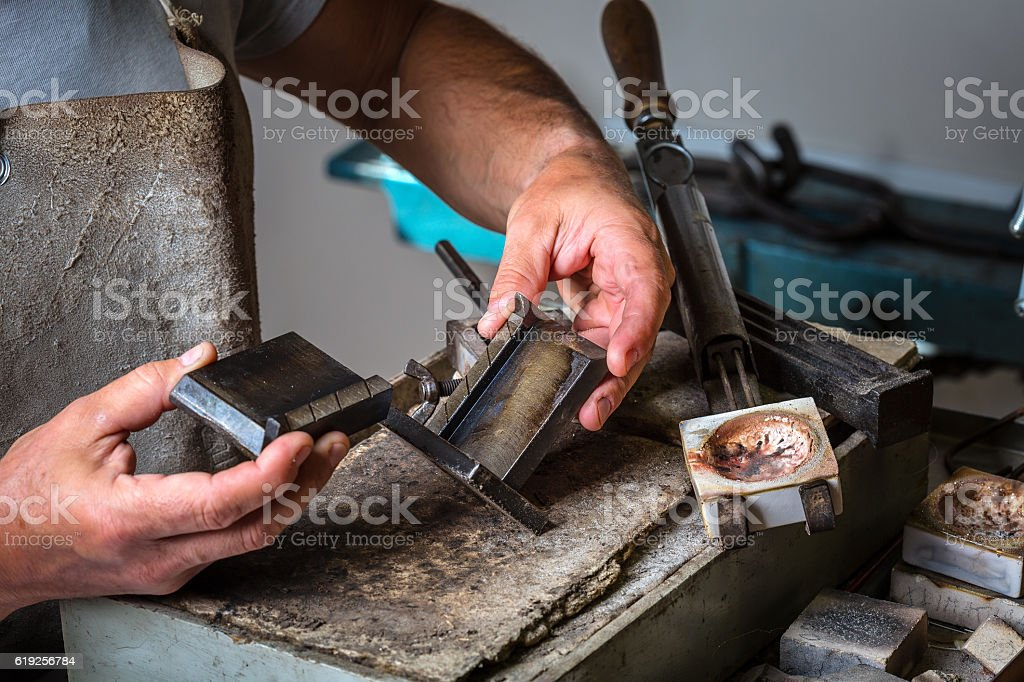 Metal Mold and Crucible at Goldsmith Workshop stock photo