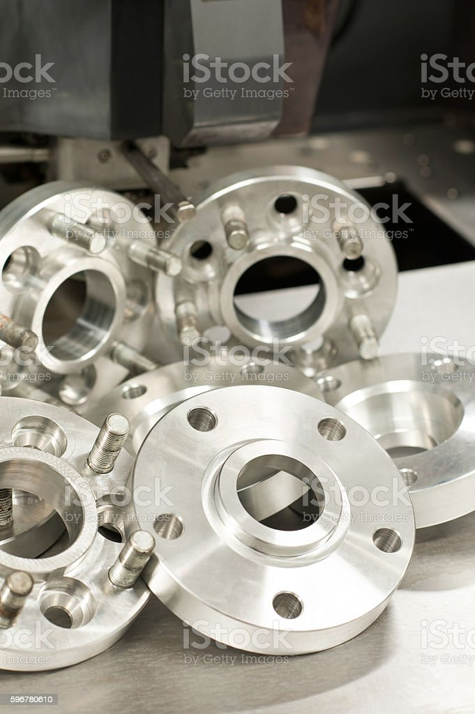 Metal mold of wheel spacers and bolts. CNC industry stock photo