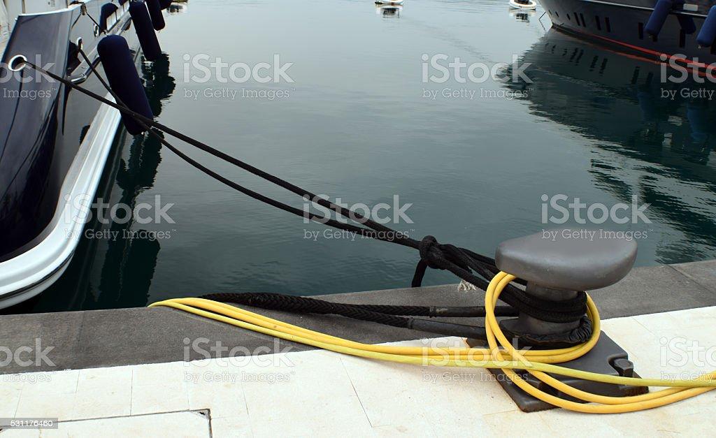 Metal mooring bollard on the dock stock photo