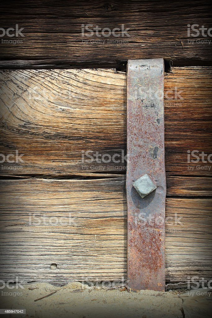metal mount on old wooden beam stock photo