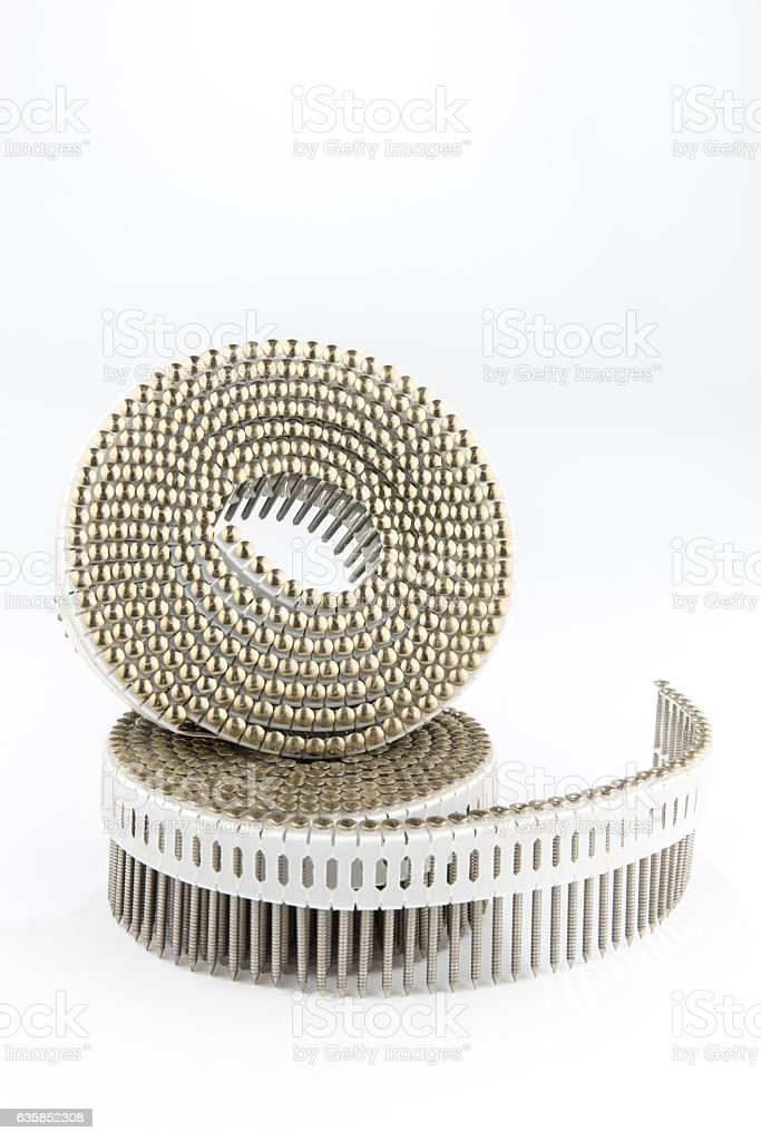 metal nails on a plastic roll for pneumatic nailers gun stock photo