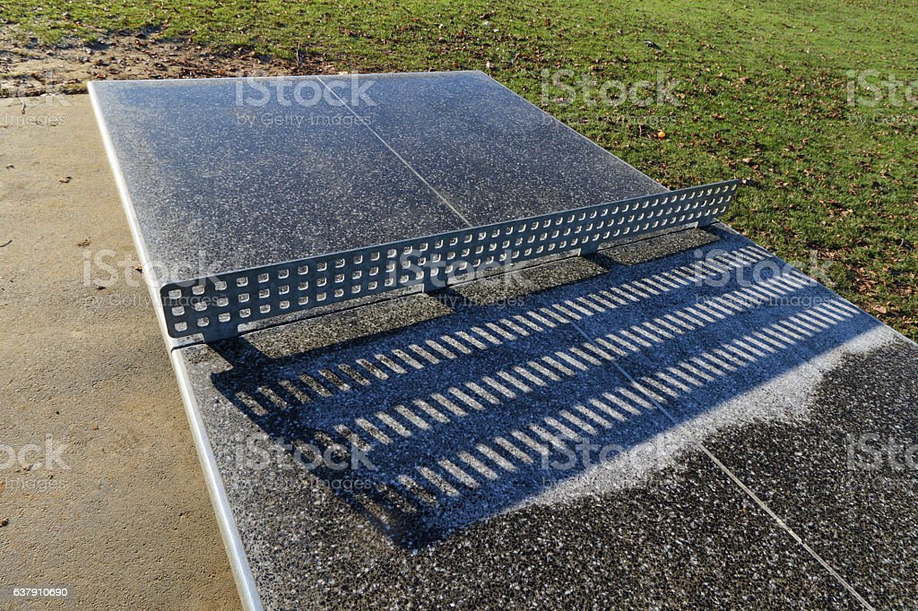 Winter outdoors table tennis table with frost stock photo
