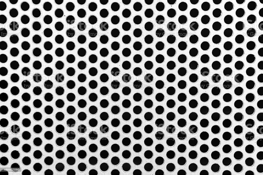 Metal net with perforated circles stock photo