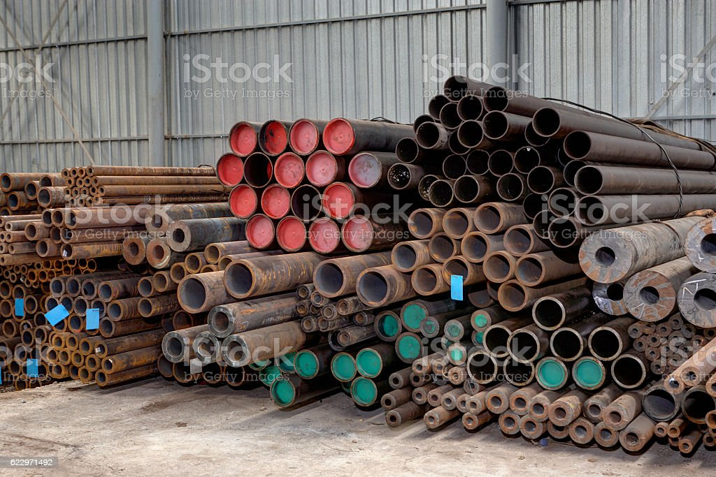Metal new pipes are stored at the factory warehouse stock photo