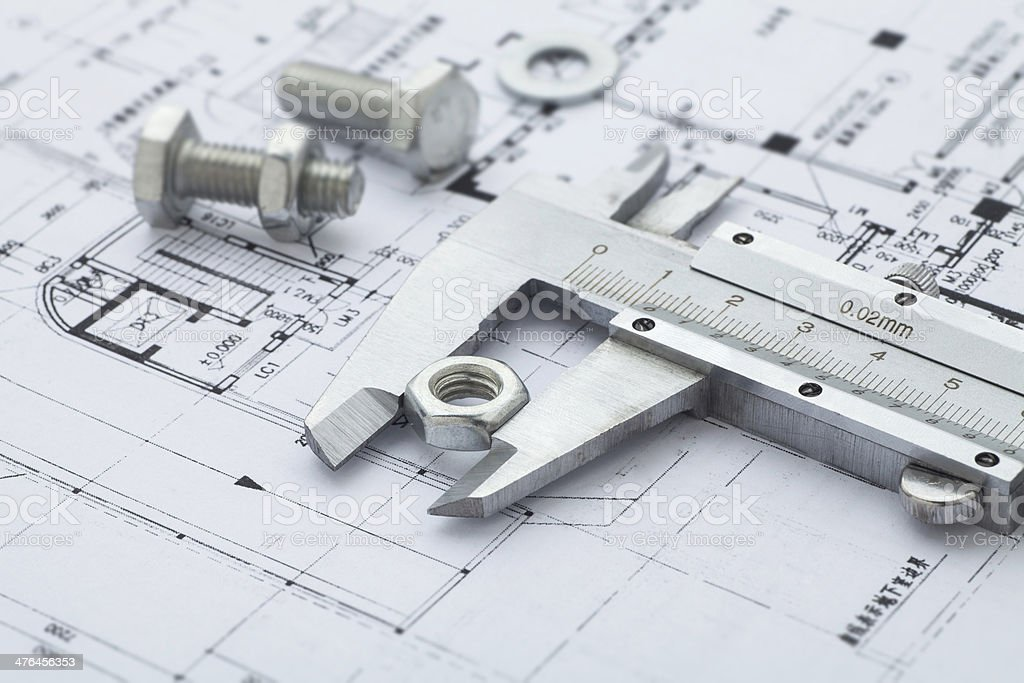 Metal nut measuring Vernier calipers on drawing stock photo