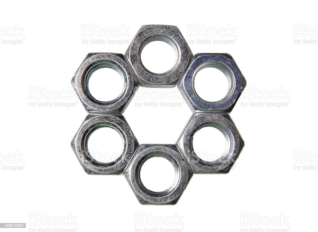 metal nuts folded into hexagonal royalty-free stock photo