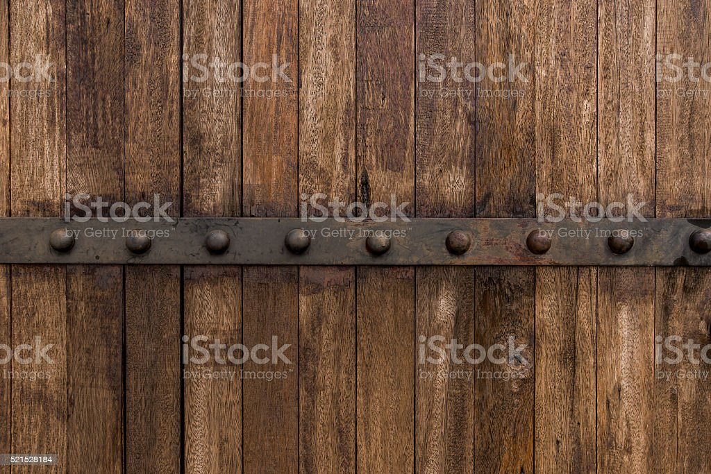 Metal on old wooden background for design stock photo