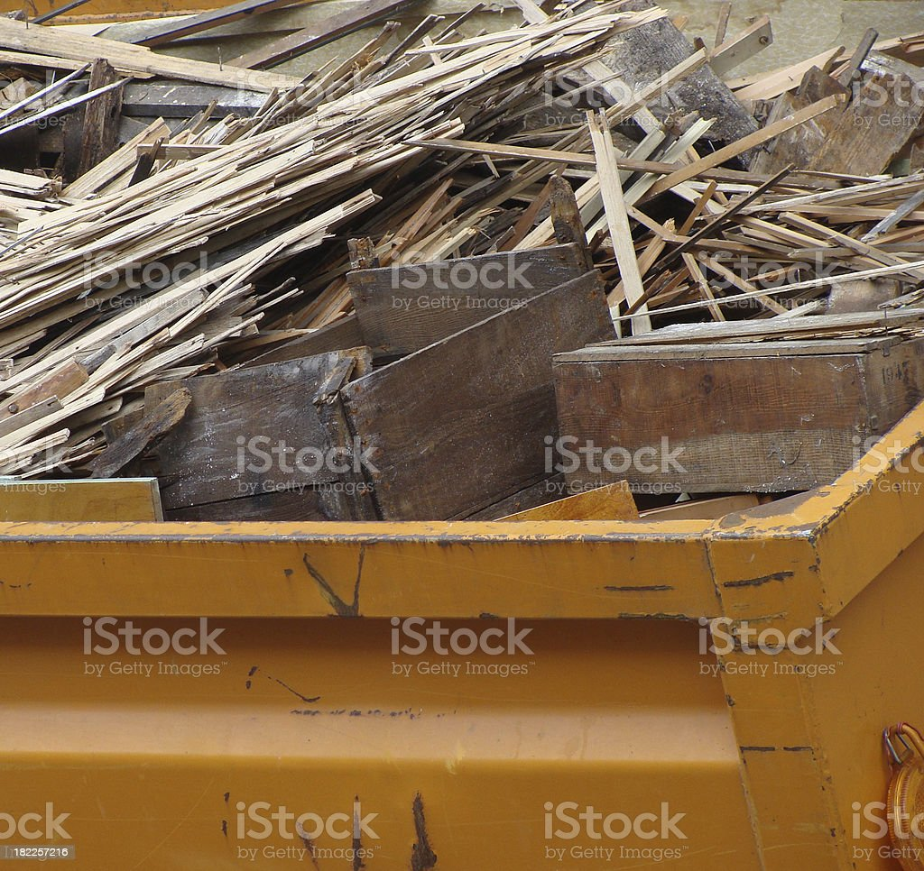 metal orange container filled with wood timber rubble royalty-free stock photo