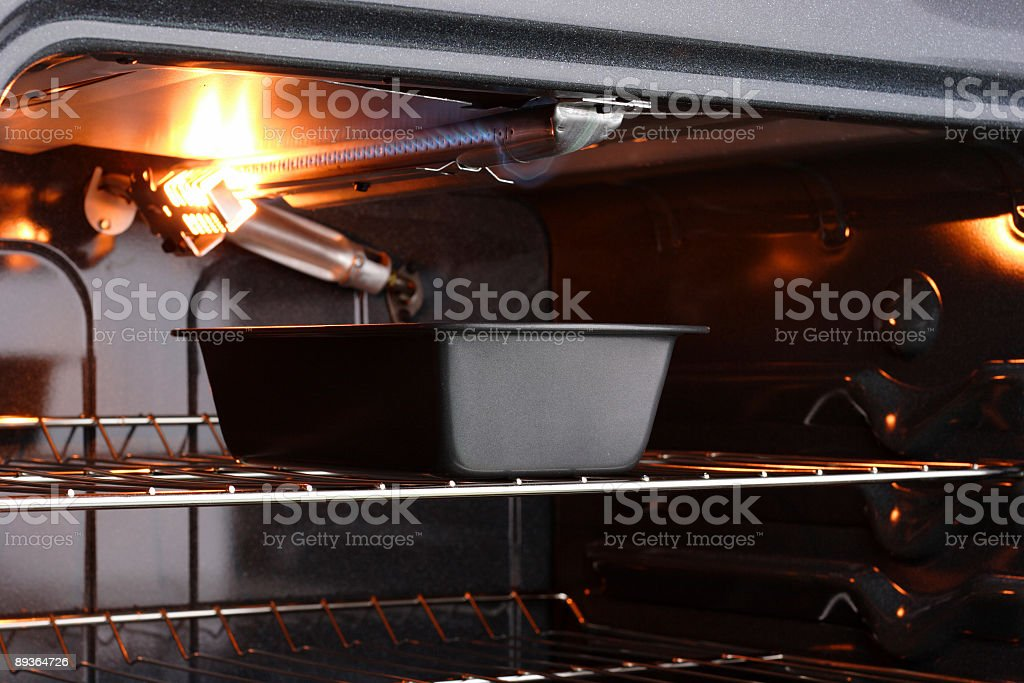 Metal Pan in Gas Oven stock photo