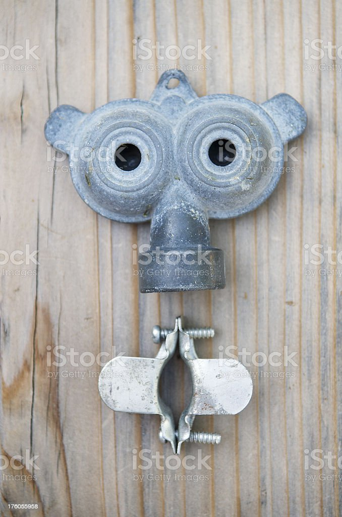 Metal Parts Make Cute Face on Wood royalty-free stock photo