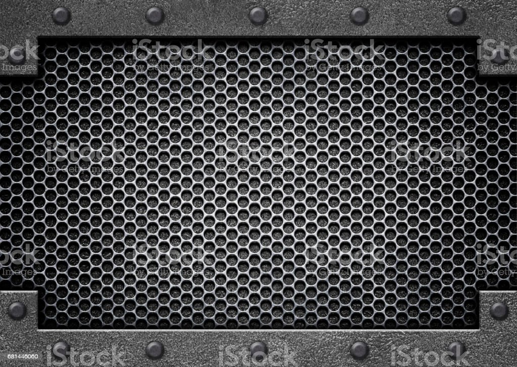 Metal perforated background with shiny stainless steel plate stock photo