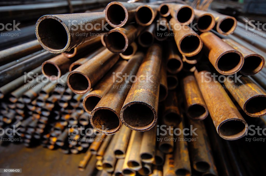 Metal pipe billets in stock stock photo