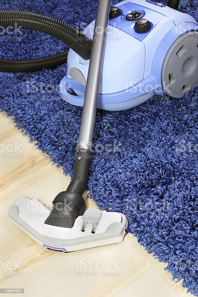 Metal pipe of vacuum cleaner in action. stock photo