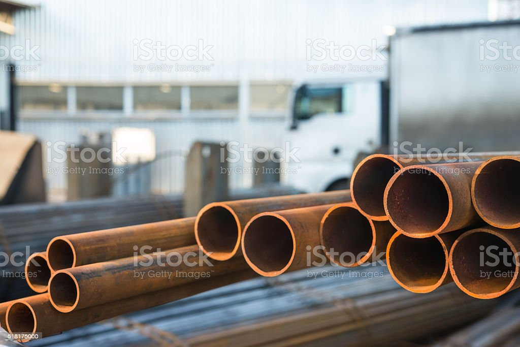 metal pipes are stored at the plant stock photo