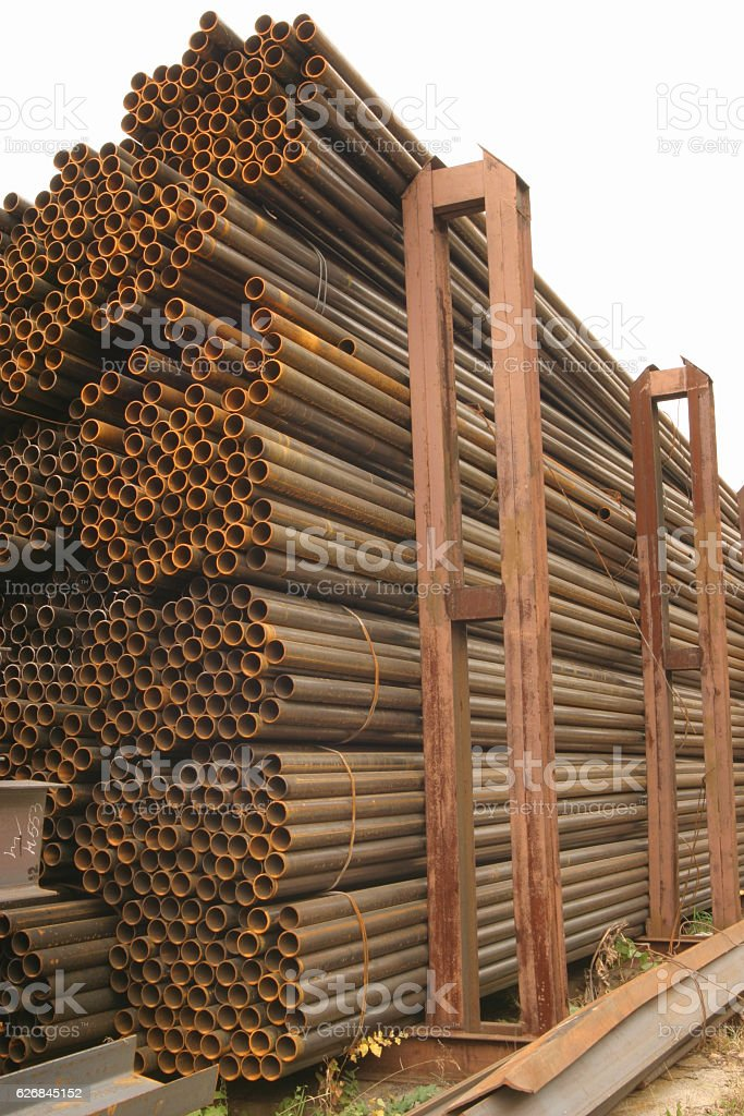 Metal pipes are stored in a warehouse hexagonal cells stock photo