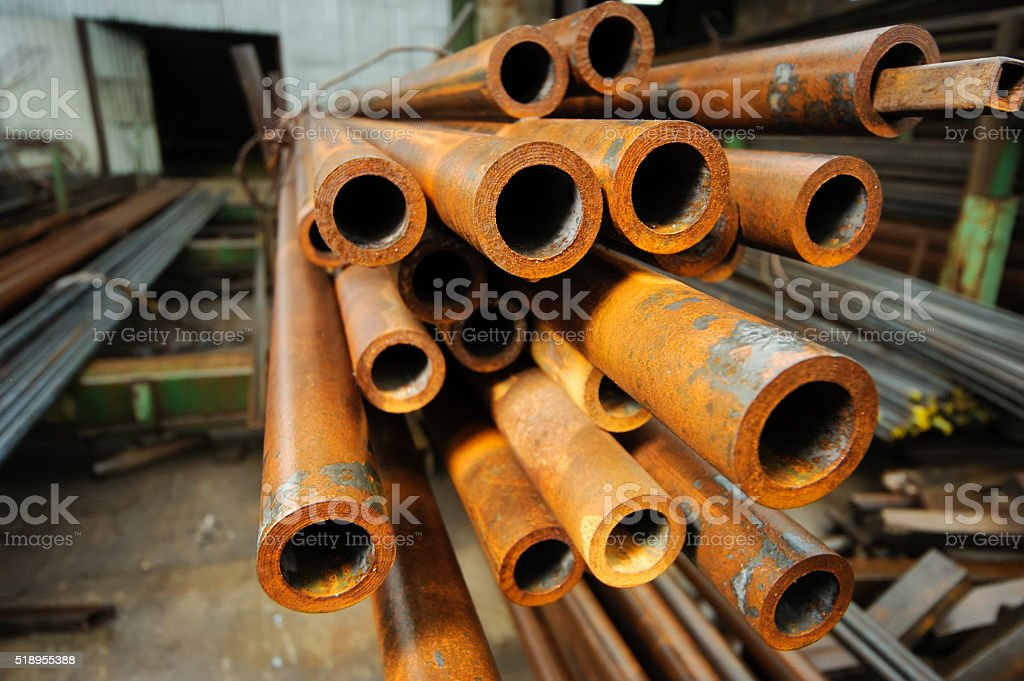 Metal pipes are stored in a warehouse. stock photo