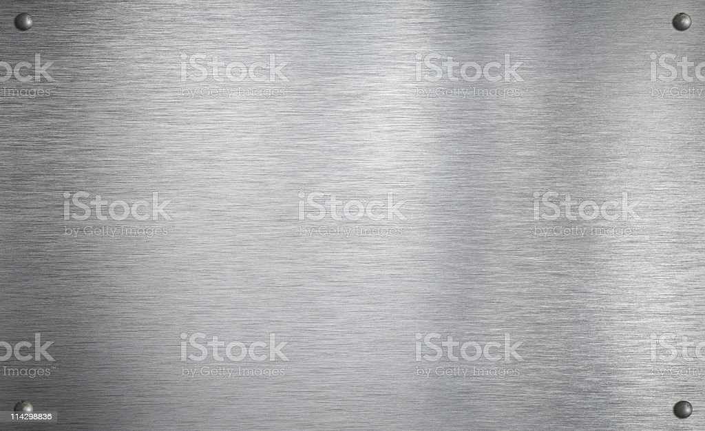 Metal plate with four rivets stock photo