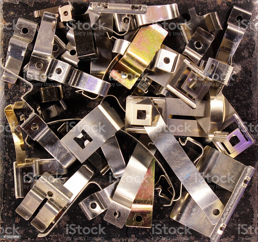 Metal plates detail and parts. Flat steel springs and clips stock photo