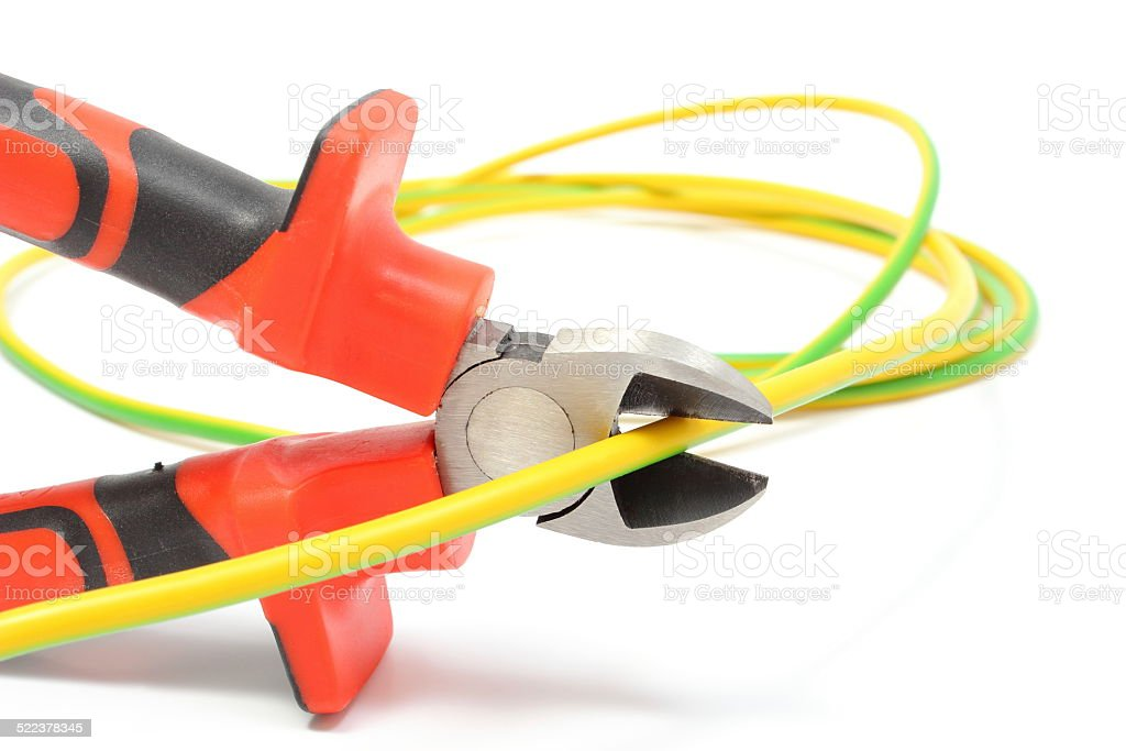 Metal pliers and green yellow cable on white background stock photo
