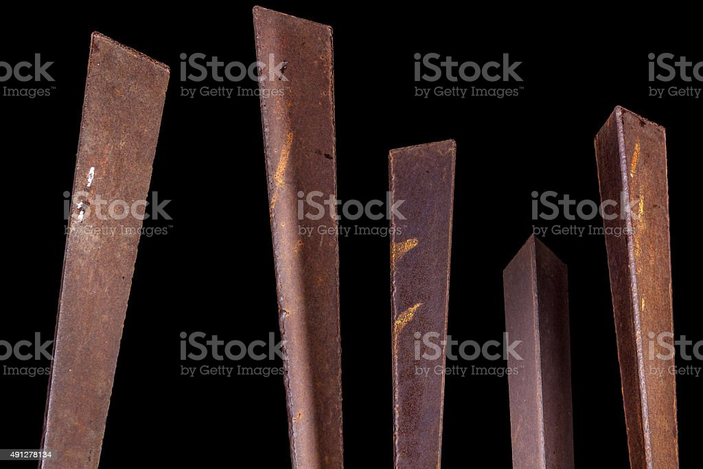 Metal poles, on black background. Abstract stock photo