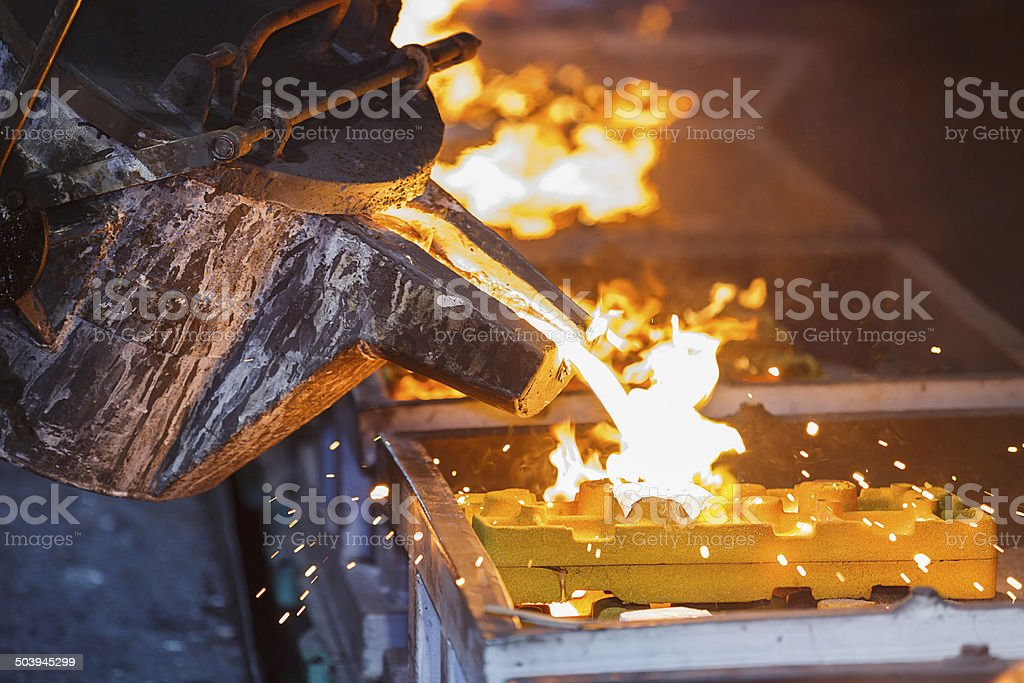 metal pouring in casting line production stock photo