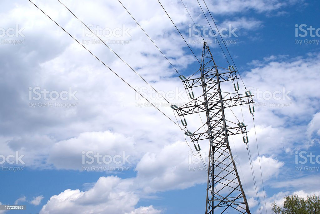 Metal prop and power line over sky with white clouds stock photo