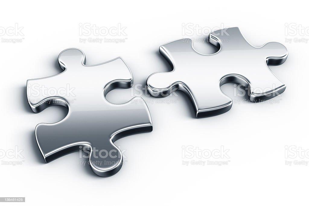 Metal puzzle pieces stock photo