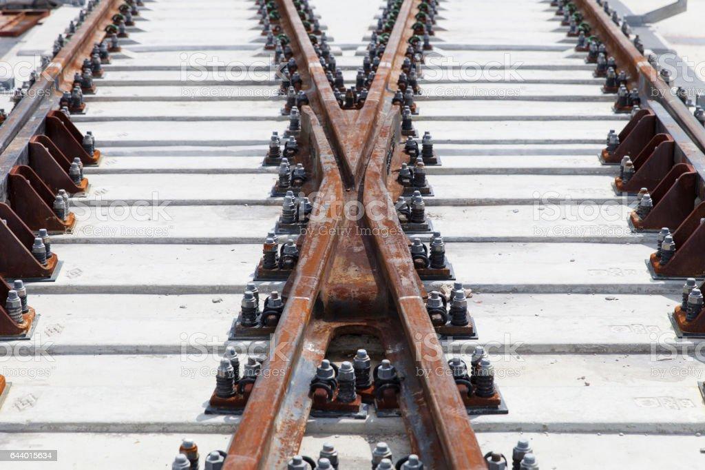 metal rail rapid electric train transit on concrete railway sleepers stock photo
