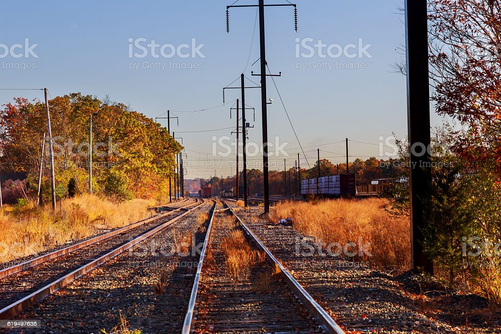 metal railway in autumn time stock photo