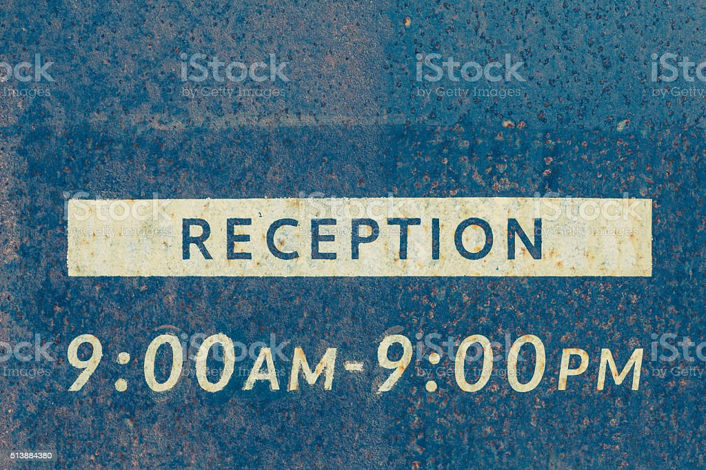 Metal reception sign board close - up stock photo