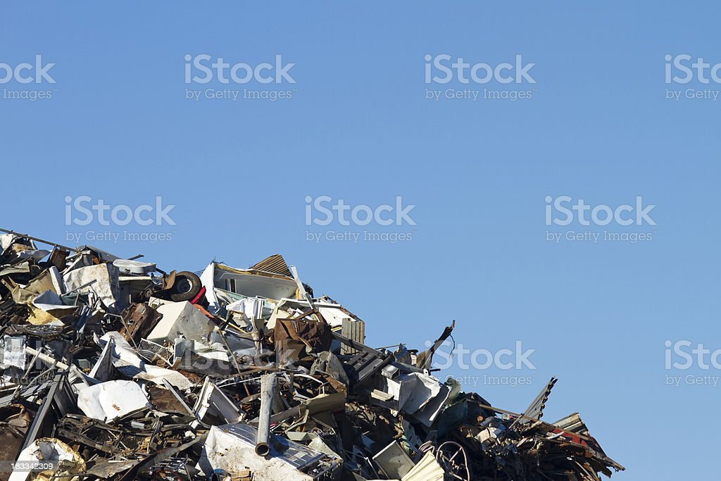 Metal Recycling Junkyard, Blue Sky In Corner, Horizontal stock photo