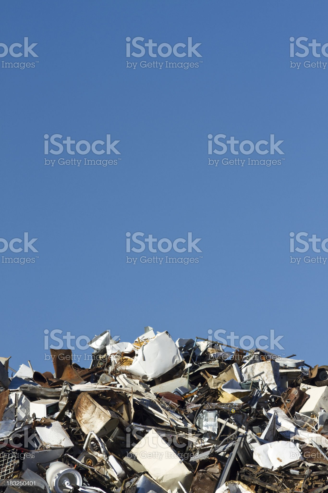 Metal Recycling Junkyard, Blue Sky Vertical, Low Horizon royalty-free stock photo