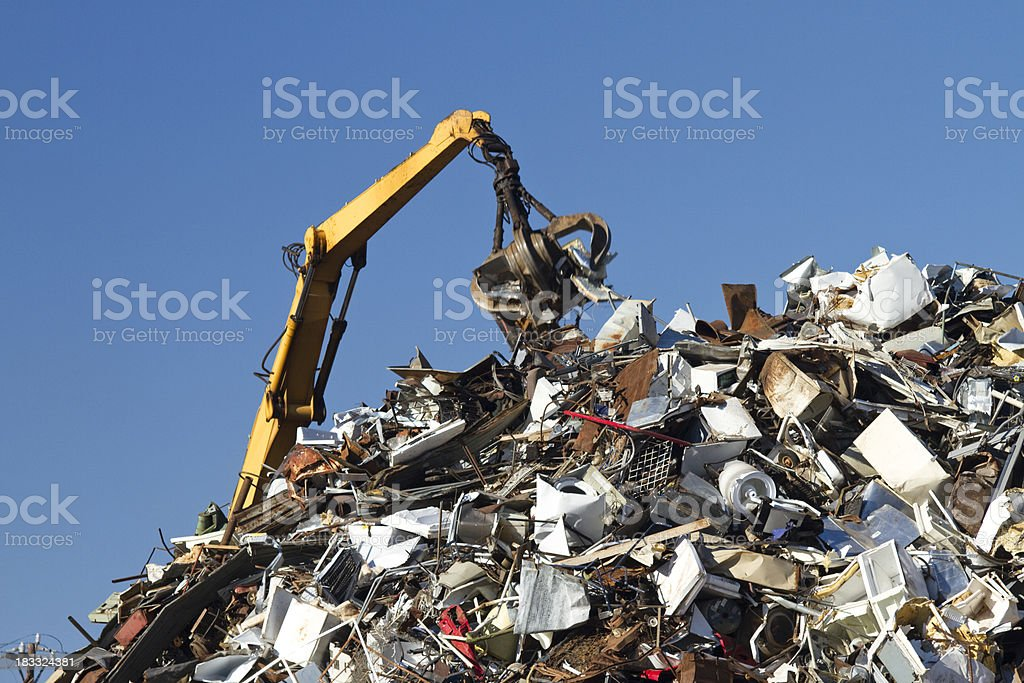 Metal Recycling Junkyard, Blue Sky, With Crane Lifting Trash royalty-free stock photo