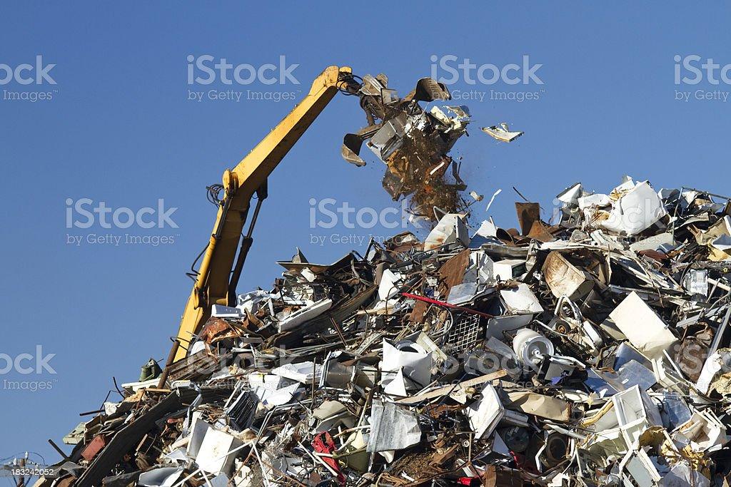 Metal Recycling Junkyard, Blue Sky, With Crane Throwing Trash royalty-free stock photo
