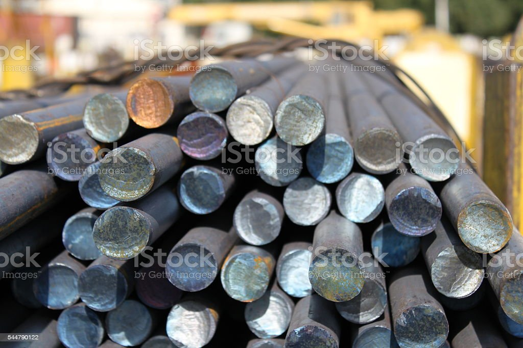 Metal rolled bar. Steel round. stock photo