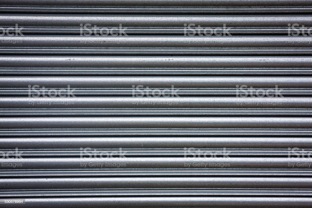 Metal roller shutter; full frame background texture stock photo