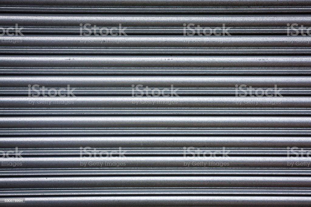 Metal roller shutter; full frame background texture stock photo