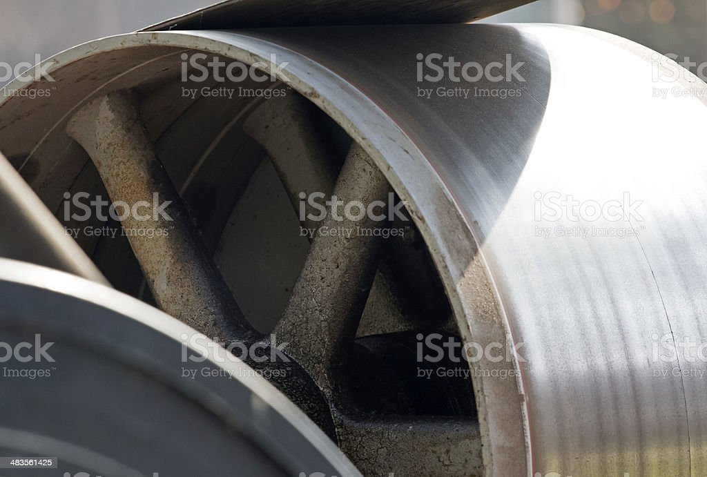 Metal rotor and belt drive in sunlight stock photo