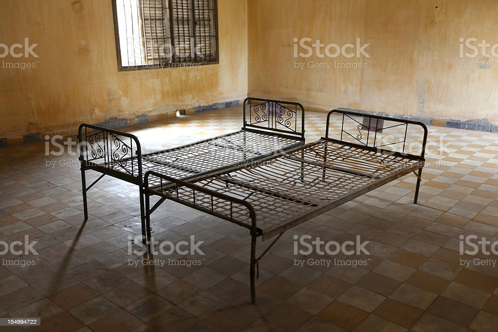 Metal rusty beds in empty prison room, Cambodia royalty-free stock photo