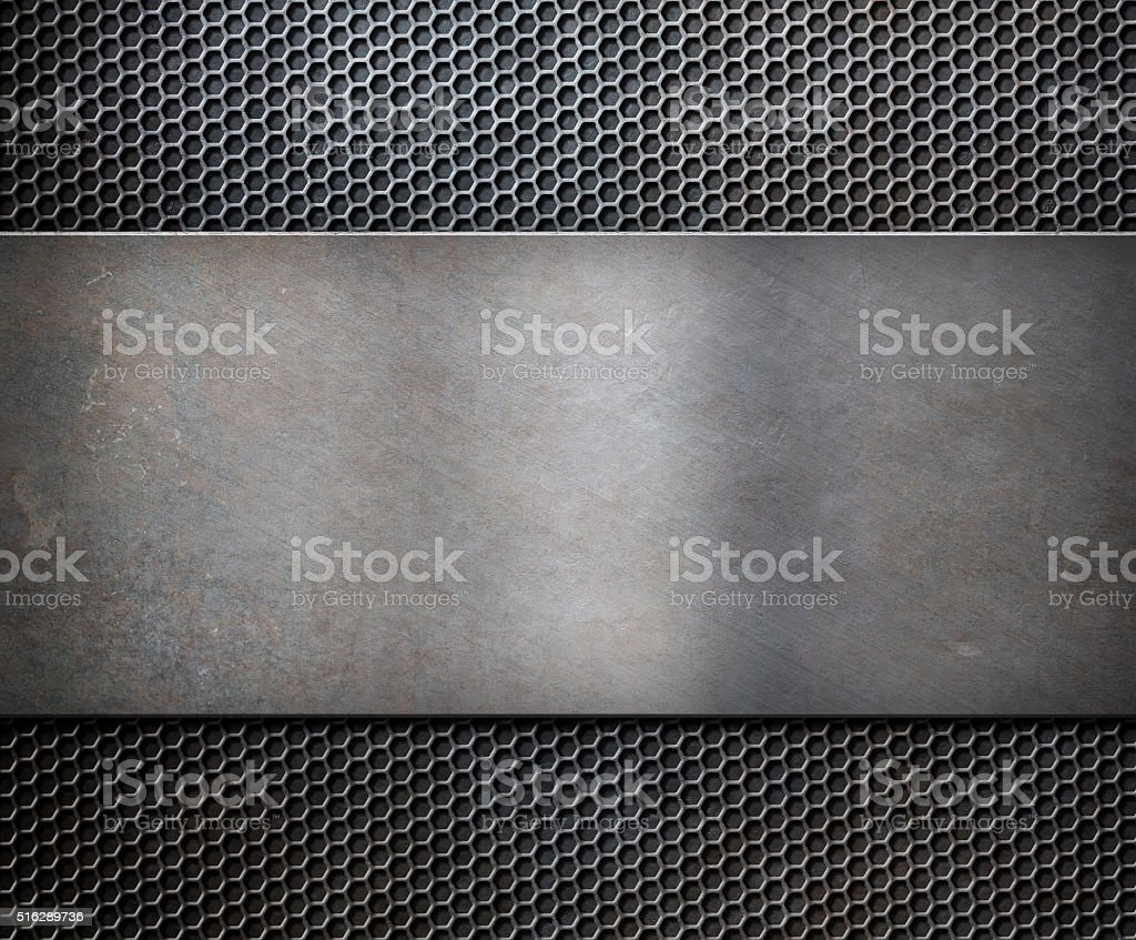 metal rusty plate over grid background stock photo