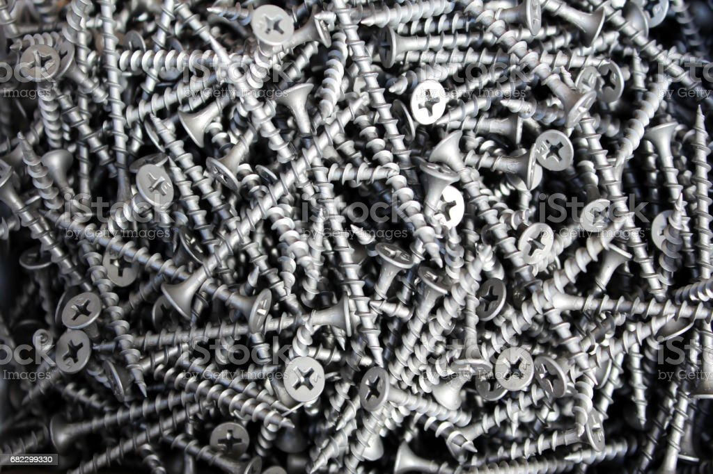 Metal screws used as the background image. stock photo