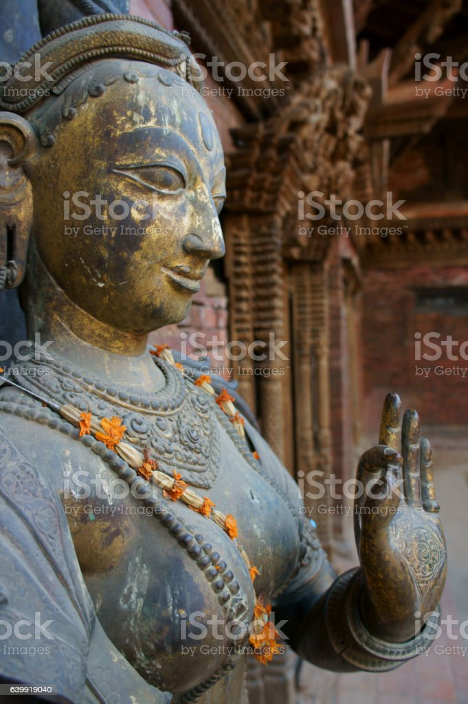 metal sculpture of goddess Ganga with flowers stock photo