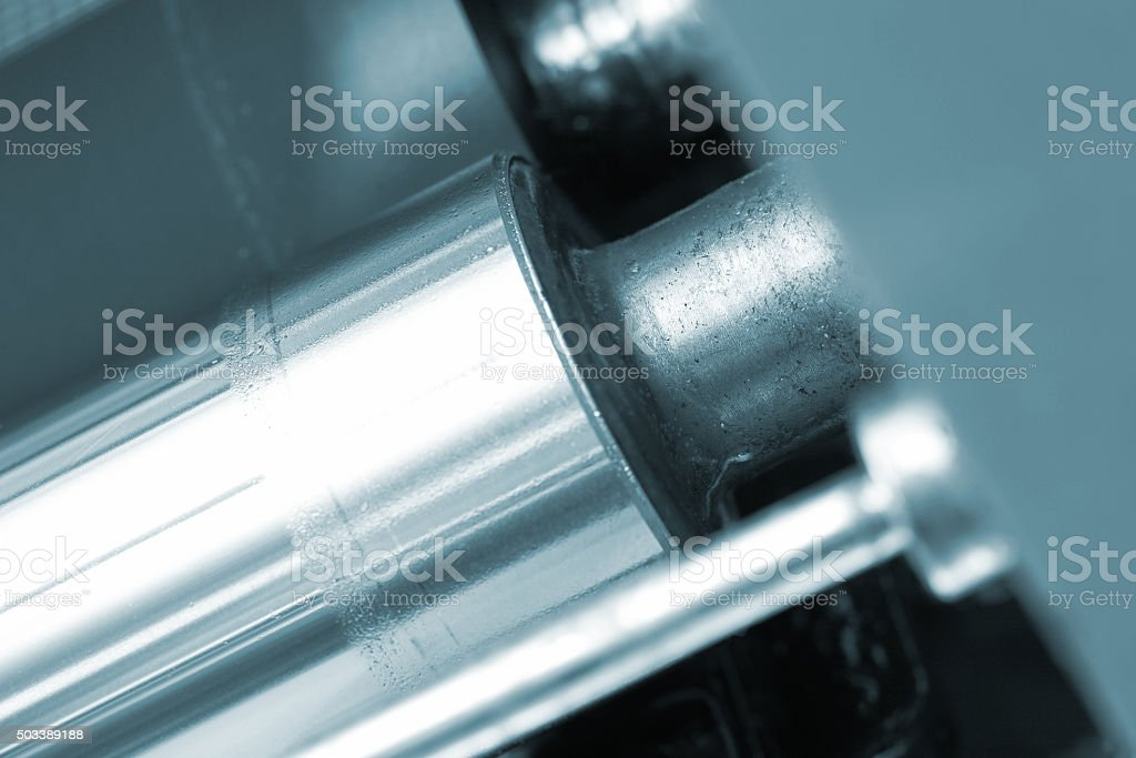 Metal shaft of the printing press stock photo
