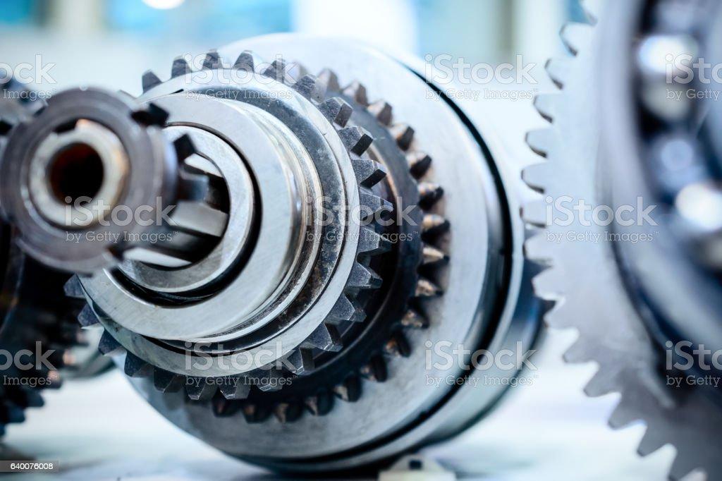 Metal shaft with gears and spline teeth. stock photo