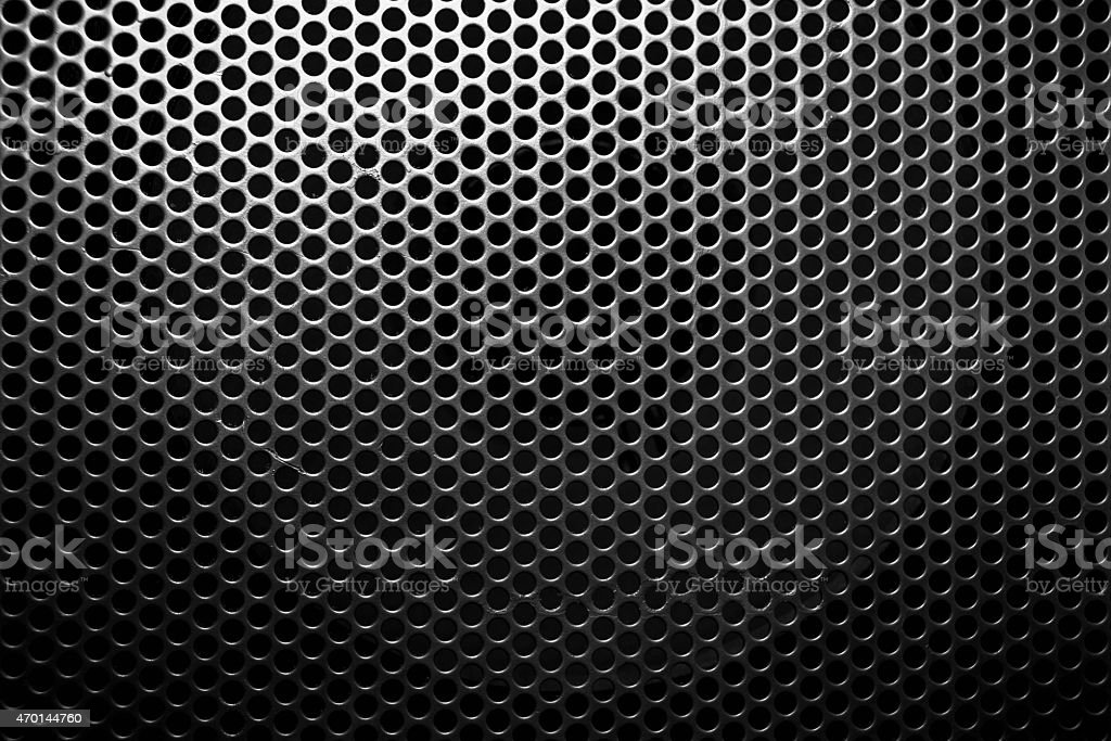 A metal sheet of mesh on a black background stock photo