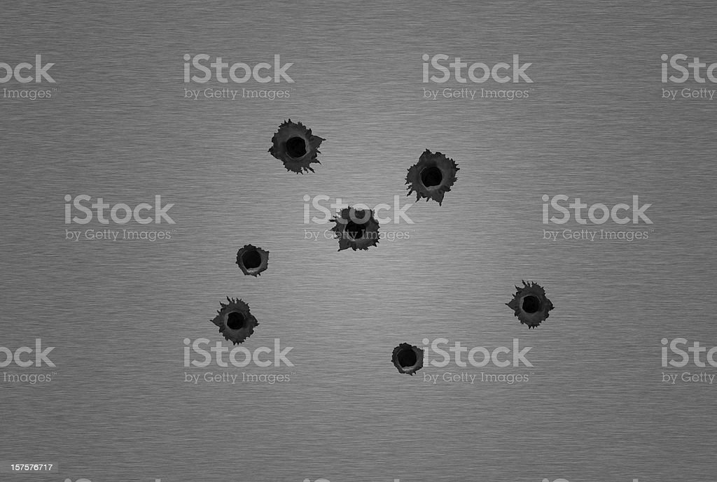 Metal sheet with bullet holes stock photo