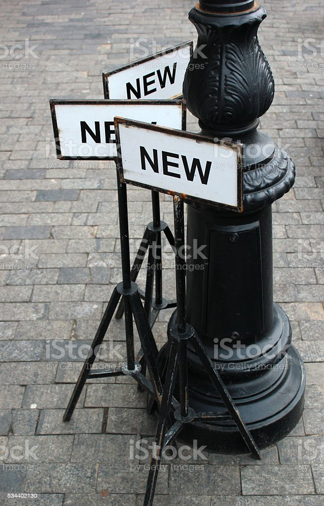 Metal sign plates with word NEW stock photo